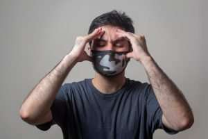 man-holding-his-head-having-a-nervous breakdown