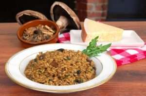 risotto with magic mushroom and cheese on top of the chopping board
