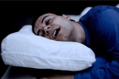 man having a psychedelic sleep with his mouth open